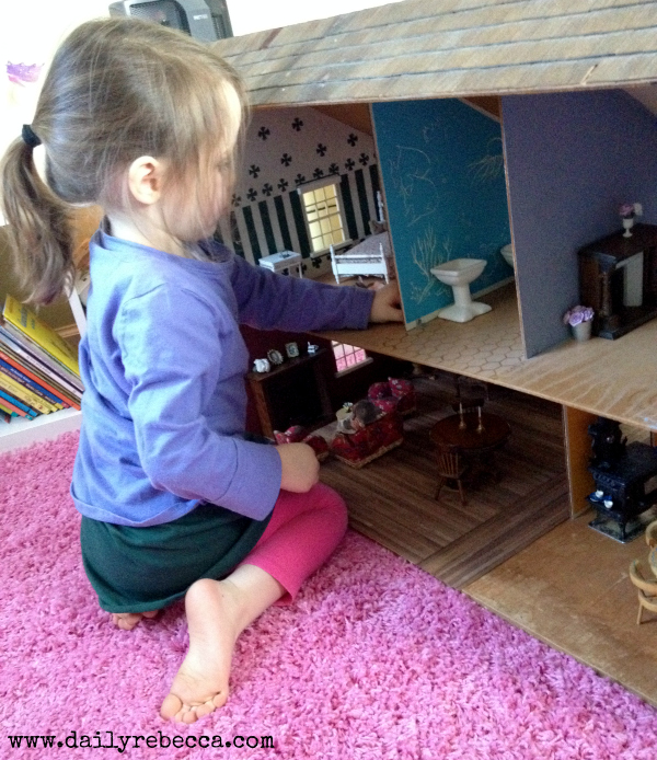 grace playing with dollhouse
